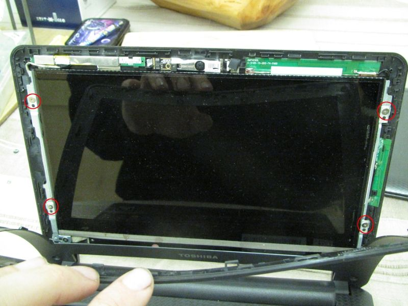 Bend the bezel out of the way and remove the four screws holding the screen panel